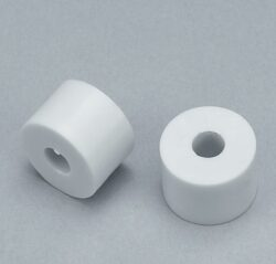 distanční podložka k šatním košům - průměr 15x10 mm, šedý plast